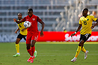July 16th 2021; Orlando, Florida, USA; Guadeloupe midfielder Edwing Malpon controls the high ball during the Concacaf Gold Cup match between Guadeloupe and Jamaica on July 16, 2021 at Exploria Stadium in Orlando, Fl.