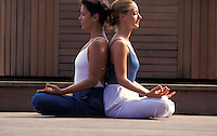 Women practicing Hatha Yoga meditation in Hawaii.