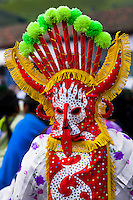 """A man dancer in a colorful costume performs Aya Uma, the creature from the Indian myths, during the Inti Raymi celebration in Pichincha province, Ecuador, 27 June 2010. Inti Raymi, """"Festival of the Sun"""" in Quechua language, is an ancient spiritual ceremony held in the Indian regions of the Andes, mainly in Ecuador and Peru. The lively celebration, set by the winter solstice, goes on for various days. The highland Indians, wearing beautiful costumes, dance, drink and sing with no rest. Colorful processions in honor of the God Inti (Sun) pass through the mountain villages giving thanks for the harvest and expressing their deep relation to the Mother Earth (Pachamama)."""
