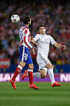 Atletico de Madrid's Juanfran (L) and Real Madrid´s James Rodriguez during quarterfinal first leg Champions League soccer match at Vicente Calderon stadium in Madrid, Spain. April 14, 2015. (ALTERPHOTOS/Victor Blanco)