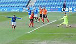 21.02.2021 Rangers v Dundee Utd: Ianis Hagi diverts the ball past Benjamin Siegrist and celebrates his goal