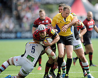 Referee Wayne Barnes gets caught up in the action as Alistair Hargreaves of Saracens is tackled by George Robson of Harlequins during the Aviva Premiership semi final match between Saracens and Harlequins at Allianz Park on Saturday 17th May 2014 (Photo by Rob Munro)