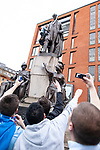 © Joel Goodman - 07973 332324 . 13/05/2012 .  Manchester , UK . Manchester City Football Club fans climb a statue of Wellington and wrap a scarf around its neck during celebrations in Piccadilly Gardens in Manchester City Centre after MCFC wins the Premiership title . Photo credit: Joel Goodman