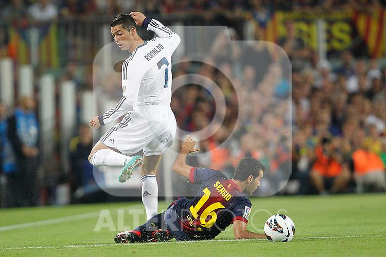 Barcelona's Sergio Busquets and Real Madrid's Cristiano Ronaldo during la Liga match on october 7th 2012. ..Photo: Cesar Cebola  / ALFAQUI