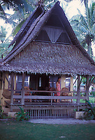 Woman on veranda of traditional Filipino home in Sagana Resort on Siargao Island