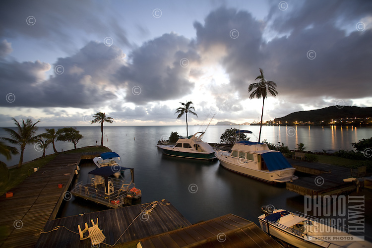 Yachts docked in Kaneohe Bay at sunset