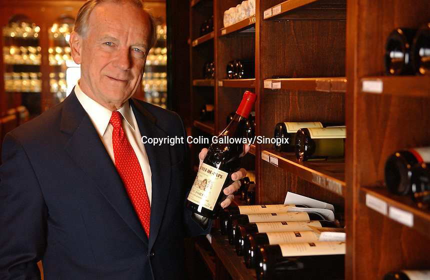Jim Thompson, CEO of Crown Wine Cellars, a private members club for wine lovers, poses in the club's wine cellar in Shousan Hill, Hong Kong.