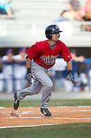 Alex Perez (8) of the Elizabethton Twins follows starts down the first base line against the Kingsport Mets at Hunter Wright Stadium on July 9, 2015 in Kingsport, Tennessee.  The Twins defeated the Mets 9-7 in 11 innings. (Brian Westerholt/Four Seam Images)