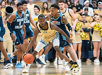 WASHINGTON, DC - FEBRUARY 8: Fatts Russell #1 of Rhode Island guards Shawn Walker Jr. #1 of George Washington during a game between Rhode Island and George Washington at Charles E Smith Center on February 8, 2020 in Washington, DC.