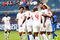 KANSASCITY, KS - JULY 11: Canada players celebrate a goal during a game between Canada and Martinique at Children's Mercy Park on July 11, 2021 in KansasCity, Kansas.