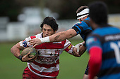 Jamie Gilbert-Clark attempts to evade Sean Bagshaw's tackle early in the Counties Manukau Premier Club Rugby game between Karaka and Onewhero, played at Karaka on Saturday June 25th 2016. Karaka won the game 15 - 10 after leading 10 - 3 at halftime.<br />  Photo by Richard Sprnger.