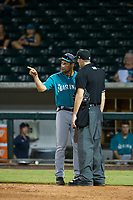 AZL Mariners manager Yoel Monzon (17) exchanges words with home plate umpire Andrew Clark during the game against the AZL Cubs on August 4, 2017 at Sloan Park in Mesa, Arizona. AZL Cubs defeated the AZL Mariners 5-3. (Zachary Lucy/Four Seam Images)