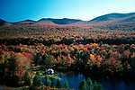 Fall foliage from on top of the Indian Head resort observation tower overlooking Shadow Lake, Lincoln, New hampshire