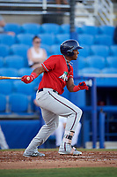 Fort Myers Miracle first baseman Lewin Diaz (11) follows through on a swing during a game against the Dunedin Blue Jays on April 17, 2018 at Dunedin Stadium in Dunedin, Florida.  Dunedin defeated Fort Myers 5-2.  (Mike Janes/Four Seam Images)