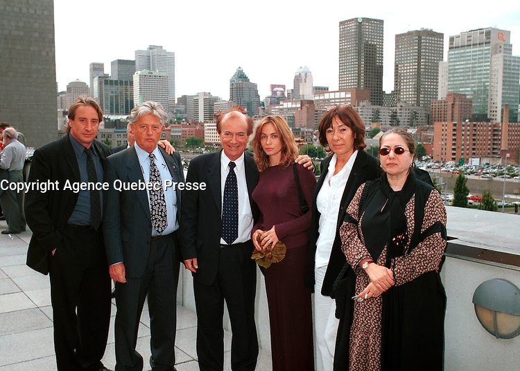 French actress Emanuelle Bear (4th from Left)  who is the President of the 25th  World Film Festival's  Jury pose with Montreal Cinema Commissary : Andre Lafond (3rd from left) and some other members of the Jury at  a reception at Montreal City Hall, august 29th , 200l in Montreal, CANADA.<br /> <br /> Brought up on a farm in Provence because her father, French singer and poet Guy BÈart didn't want her to be affected by the glamour world of Paris showbusiness, Emmanuelle BÈart nevertheless got the acting urge in early adolescence. At age 15, after a couple of bit parts, she came to Montreal as an au pair to learn English. Back in France, after acting lessons and few small roles in television, she made her big-screen breakthrough in the title role of Claude Berri's Pagnol adaptation, MANON OF THE SPRING (1986). A year later she made her Hollywood debut in Tom McLoughlin's DATE WITH AN ANGEL. She has since played for some of the premier directors on both sides of the Atlantic: Rivette (LA BELLE NOISEUSE, 1991), Sautet (NELLY AND MR. ARNAUD (1995), Chabrol (L'ENFER,1994), De Palma (MISSION: IMPOSSIBLE, 1996) and Ruiz (TIME REGAINED, 1999). She stars in Catherine Corsini's REPLAY, showing at this year's Festival.<br /> <br /> <br /> Photo by John Raudsepp / Getty Images<br /> (ON SPEC- Scanned & Transmitted  by & Payable to<br /> Pierre Roussel)<br /> <br /> NOTE : 35mm film scan