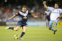 MELBOURNE, AUSTRALIA - FEBRUARY 18, 2010: Nick Ward from Melbourne Victory kicks the ball in the first leg of the A-League Major Semi Final match between the Melbourne Victory and Sydney FC at Etihad Stadium on February 18, 2010 in Melbourne, Australia. Photo Sydney Low www.syd-low.com