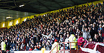 Jubilant Hearts fans celebrate with the score at the other match in their favour but not for long