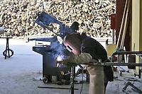 - Abbiategrasso (Mi), montaggio di un impianto per lo sfruttamento di biomasse (legname di scarto) per la produzione di energia elettrica, acqua calda per il teleriscaldamento e pellets (combustibile ecologico)<br /> <br /> - Abbiategrasso (Mi) assembly of a plant for exploitation of biomass (wood waste)  to produce electricity, hot water for district heating and pellets (ecological fuel)