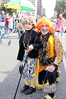 """Donald Celentano and his son Wyatt at a parade in Buddy D's honor on January 31, 2010 in New Orleans.<br /> <br /> Thousands of Saints fans wearing dresses paraded from the Louisiana Superdome to the French Quarter to honor a promise made by the late sportscaster and Saints super-fan Buddy Diliberto aka """"Buddy D"""".<br /> <br /> In 1993 Buddy D, who passed away in 2005, remarked on air that if the Saints were to make it to the Super Bowl, he would wear a dress and dance down the streets.  The comment was repeated at various times and never forgotten by his listeners.<br /> <br /> Led by former New Orleans Saints quarterback Bobby Hebert, who has taken Buddy D's place on WWL radio, thousands made good on his promise for him, dancing, drinking, and cavorting their way down the street, alternately yelling out """"Who Dat!"""" and """"Buddy D!"""" in front of an onlooking crowd an estimated 85,000 people strong.<br /> <br /> The hard luck NFL team the New Orleans Saints has reached its first Super Bowl in team history, after 43 years largely filled with losing seasons and futility.  It is difficult to travel anywhere in the area without some reminder of this fact, as the team and city are intertwined perhaps like no other sports franchise in this country."""