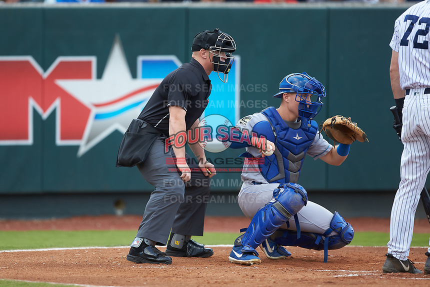 Home plate umpire Lane Culipher looks over the shoulder of Burlington Royals catcher William Hancock (7) during the game against the Pulaski Yankees at Calfee Park on September 1, 2019 in Pulaski, Virginia. The Royals defeated the Yankees 5-4 in 17 innings. (Brian Westerholt/Four Seam Images)