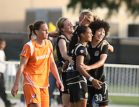 Leigh Ann Robinson (7) is congratulated by teammates after scoring the winning goal against Sky Blue FC, at Buck Shaw Stadium, in Santa Clara, Calif., Sunday, May 3, 2009.