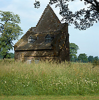 The dovecote at Glamis Castle stands in an overgrown field