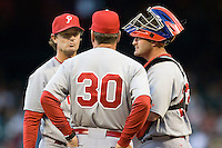 Philadelphia Phillies pitcher Jamie Moyer  talks with pitching coach Rich Dubee (30) against the Houston Astros on Turn Back the Clock Nite. Game played on Saturday April 10th, 2010 at Minute Maid Park in Houston, Texas.  (Photo by Andrew Woolley / Four Seam Images)