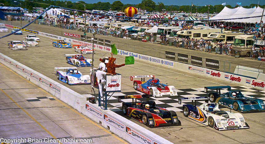The Exxon tiger waves the green flag to start the 12 Hours of Sebring , Sebring Raceway, Sebring , FL, March 15, 1997.  (Photo by Brian Cleary/www.bcpix.com)