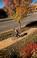 A man rides a mountain bike in Asheville NC's Biltmore Park Town Square, a planned community in the Blue Ridge Mountains of residential living, office spaces and shopping.