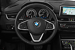 Car pictures of steering wheel view of a 2018 BMW 2 Series 225xe iperformance 5 Door Mini Van