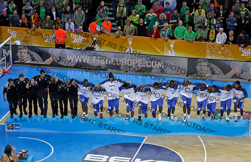 French national basketball players pose for the photo, second place, after final Eurobasket 2011 game between Spain and France in Kaunas, Lithuania, Sunday, September 18, 2011. (photo: Pedja Milosavljevic)