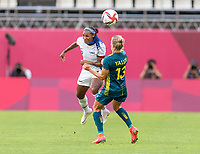 KASHIMA, JAPAN - JULY 27: Crystal Dunn #2 of the USWNT goes up for a header with Tameka Yallop #13 of Australia during a game between Australia and USWNT at Ibaraki Kashima Stadium on July 27, 2021 in Kashima, Japan.