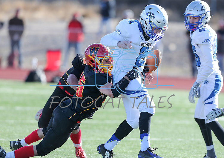 Whittell's Kai Mangiaracina knocks the ball loose from Pahranagat Valley quarterback Tabor Maxwell during the second half of the NIAA DIV championship game against Whittell High at Dayton High School in Dayton, Nev., on Saturday, Nov. 21, 2015. Pahranagat Valley won 54-28. (Cathleen Allison/Las Vegas Review Journal)