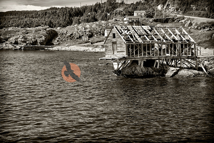 Dilapidated fishing shack in a harbor in Newfoundland. Image is in black and white