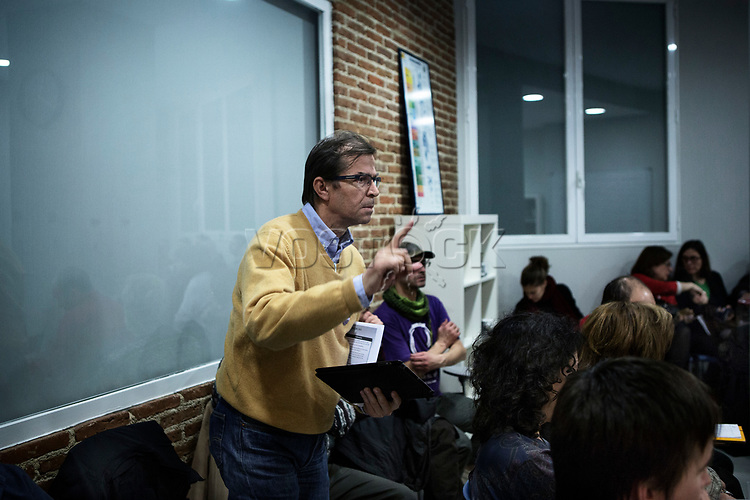 Madrid, Spain, February 12, 2015. A member of the left wing [party] Podemos delivers a question during their weekly meeting in Salamanca's neighbourhood in Madrid.