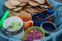 Antigua, Guatemala.  A Street Vendor's Snack Tray: Guacamole, Beans, Onions, hot sauce, tortillas.