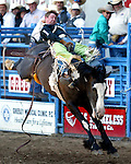 Greeley, Colorado cowboy Royce Ford scored an 85 point bareback ride on the Buetler & Son bronc No Date Kate in front of his hometown fans at the July 29th performance of the Greeley Independence Stampede.