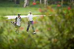 Ian Poulter of England walks with his caddie during Hong Kong Open golf tournament at the Fanling golf course on 24 October 2015 in Hong Kong, China. Photo by Xaume Olleros / Power Sport Images