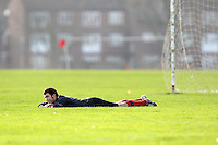 The FC Veleciku goalkeeper lies on the grass during an East London Sunday League match at Hackney Marshes - 27/01/08 - MANDATORY CREDIT: Gavin Ellis/TGSPHOTO - Self billing applies where appropriate - Tel: 0845 094 6026