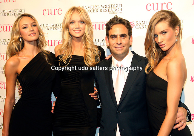 Victoria Secret Models Candice Swanepoel, Lindsay Ellingson, Michael Nierenberg and Victoria Secret Model Rosie Huntington-Whiteley attend the 12th Annual Collaborating For a Cure Dinner & Auction to benefit the Samuel Waxman Cancer Research Foundation at the Park Avenue Armory, November 18, 2009 .