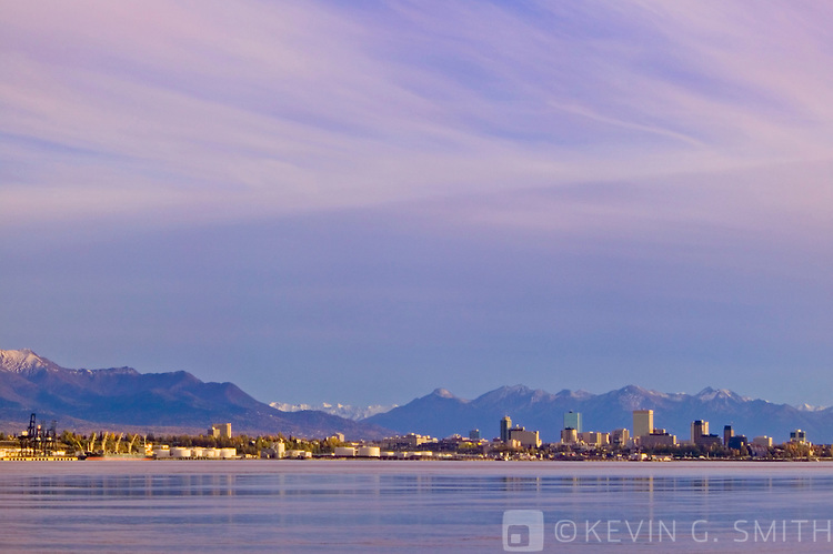 View of downtown Anchorage skyline and port from across Knik Inlet, shot from the port at Point Mckensie. Kenai mountains in background. Fall, Anchorage Alaska.