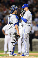 Toronto Blue Jays pitcher Dustin McGowan (29) talks with catcher Dioner Navarro (30) during a game against the Chicago White Sox on August 15, 2014 at U.S. Cellular Field in Chicago, Illinois.  Chicago defeated Toronto 11-5.  (Mike Janes/Four Seam Images)