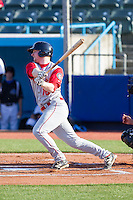 Michael Katz (18) of the Brooklyn Cyclones follows through on his swing against the Hudson Valley Renegades at Dutchess Stadium on June 18, 2014 in Wappingers Falls, New York.  The Cyclones defeated the Renegades 4-3 in 10 innings.  (Brian Westerholt/Four Seam Images)