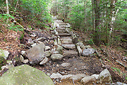 Stone staircase along the Mt Tecumseh Trail in Waterville Valley, New Hampshire in July 2015. Built around 2014 and seen here in July 2015, this appears to be considered completed trail work. However, the left-side looks unfinished.