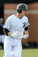 Third baseman Jake Beaver (11) of the University of South Carolina Upstate Spartans runs out a single in the first inning of a game against the Winthrop University Eagles on Wednesday, March 4, 2015, at Cleveland S. Harley Park in Spartanburg, South Carolina. Upstate won, 12-3. (Tom Priddy/Four Seam Images)