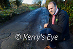 Marcus Kelliher shown the condition of the road surface near his home in Banemore on Thursday.