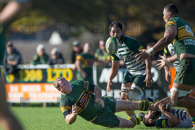 Mark Price gets the ball away to Cameron Skelton as he goes to ground. Counties Manukau Premier Club Rugby game between Pukekohe and Manurewa, played at Colin Lawrie Fields, Pukekohe, on Saturday May 28th, 2016.Pukekohe won the game 62 - 18 after leading 19 - 10 at halftime.  Photo by Richard Spranger.