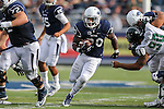Nevada running back James Butler (20) runs up the middle in an NCAA college football game against Hawaii in Reno, Nev., on Saturday, Oct. 24, 2015. (AP Photo/Cathleen Allison)