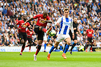 Ashley Young of Manchester United (18) and Solly March of Brighton & Hove Albion (20)  challenge for the ball  during the Premier League match between Brighton and Hove Albion and Manchester United at the American Express Community Stadium, Brighton and Hove, England on 19 August 2018. Photo by Edward Thomas / PRiME Media Images.