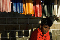 A boy is selling candles near a christian church near Bollywood, Mumabi India